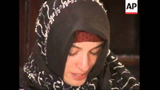 French aid worker released by the Taliban holds tearful press conference