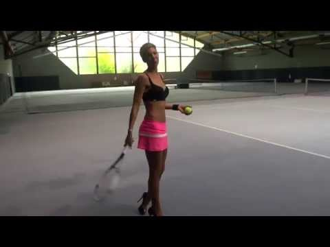 TAMIA PLAYS TENNIS OF COURSE IN HIGH HEELS