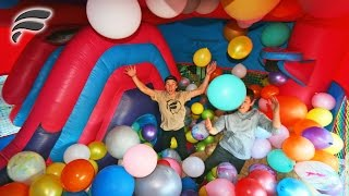 BOUNCE HOUSE SLIDE FILLED WITH BALLOONS!
