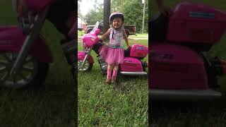 3-year-old picks up a mini Harley Davidson in Mobile
