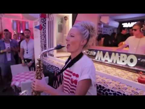 Cute girl playing saxophone