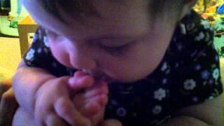 Ileana babbling and eating her feet