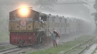 Token Exchange In Deep Rain- High-speed Bijoy Express Train On Sitakunda Railway Station