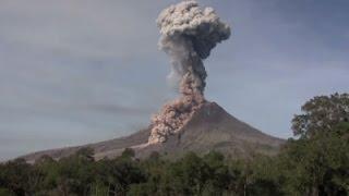 Raw: Indonesia's Sinabung Volcano Spews Hot Ash