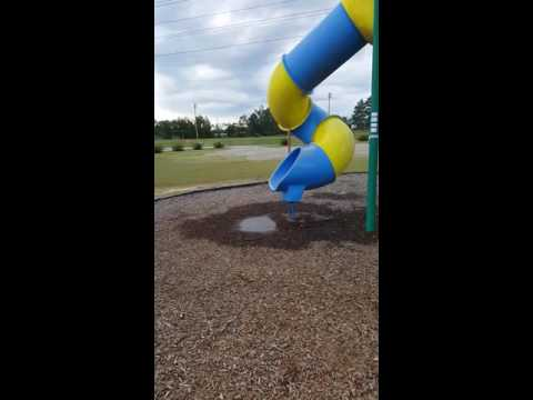 Fat man stuck in slide