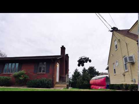 Off Road Vehicle Jumps Over House