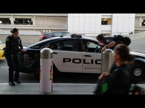 Xxx Mp4 LAX Airport Police Arresting An Employee Allegedly Stealing Headphones In Tsa 3gp Sex