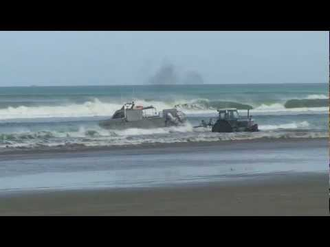boat launch  big shorebreak waves New Zealand 90 mile beach