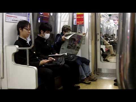 People sleeping on a Japanese Train