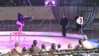 Circus - lady shooting a bow with her legs!