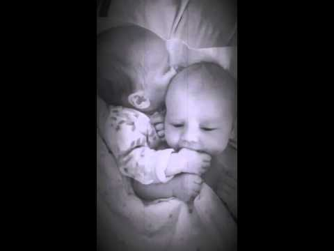 Newborn twin helps her brother stop crying