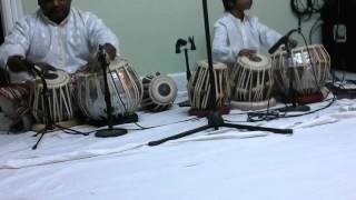 Father and son play tabla in church
