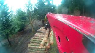 Timber truck loading 12 ft bars from above