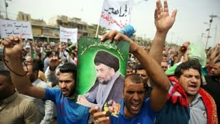 """مظاهرات في بغداد ل""""محاكمة من تسببوا"""" في دخول تنظيم """"الدولة الإسلامية"""" إلى العراق"""
