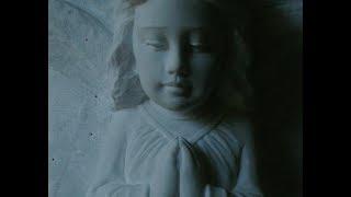 Angel statue in Carrara Statuario marble, hand carved by AC Button II Carolina Sculpture Studio
