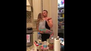 Dad Dances with Daughter in Kitchen