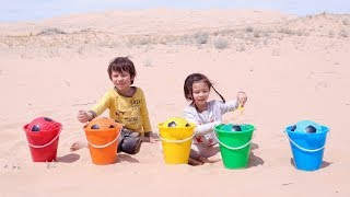 Learn Colors with Soccer Ball and Wrong Color Sand Buckets for Children
