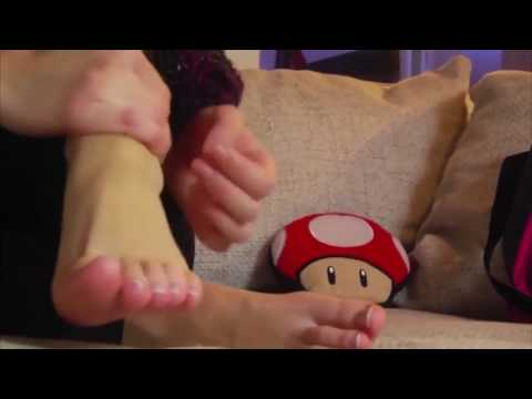 Sweet girl takes her socks off and massages her hot feet