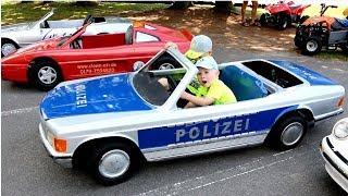 Polizei Zeichentrick Kinder Film über Elektro Polizei Auto in real live