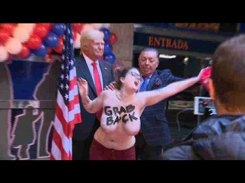 Feminist activist flashes breasts as protest against Trump in Madrid