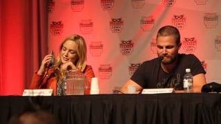 Caity Lotz and Stephen Amell during the Arrow panel at Denver Comic Con 2014