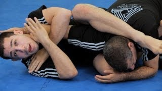How to Do a Rolling Arm Bar from Guard | MMA Submissions