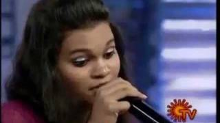 Singer Prasanna and Madhumitha Shankar singing 'Idhazhil Kadhai Ezhudhum' song
