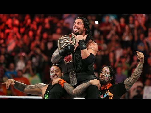 Roman Reigns celebrates winning the WWE World Heavyweight Title with his family: Dec. 14, 2015