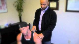 Dr. Saddik treats Greg with Active Release and Chiropractic