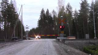 Freight train T 3479 passed KOVALA (Km.0414+0398) level crossing in Hankasalmi, Finland