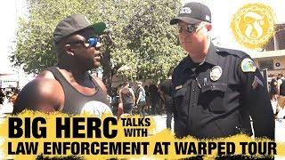 Big Herc talks with Law Enforcement at Warped Tour