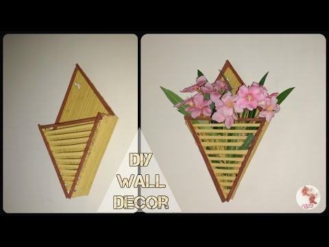 Download video diy newspaper wall hanging paper craft for Things made by waste paper