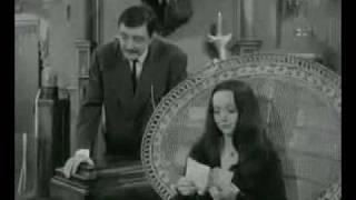 addams family in the chair