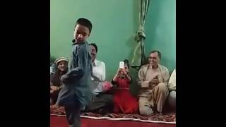A Chitral kid dances to the Khowar tunes