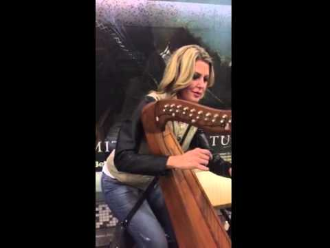 Melanie moon commandeers harp in a tube tunnel