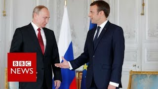 France's Macron holds 'frank exchange' with Putin - BBC News