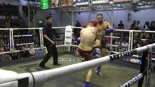 Johnny from Australia (Red corner/Sinbi Muay Thai) fights at Bangla Stadium- 8/2017