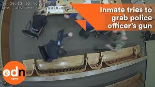 Shocking footage of Inmate trying to grab police officer