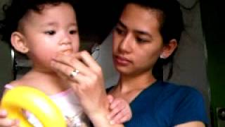 Eliz Eating Empanada