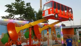 Outdoor playground for kids with flying bus. Funny video from KIDS TOYS CHANNEL