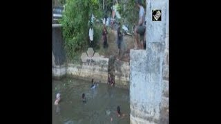 India News - Devotees take part in fish catching festival in southern India