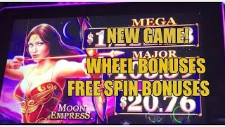 NEW-MOON EMPRESS SLOT MACHINE-WHEELAND FREE SPIN BONUSES