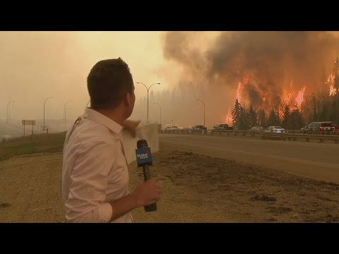 Caught on camera Fort McMurray fire erupts behind Global News reporter