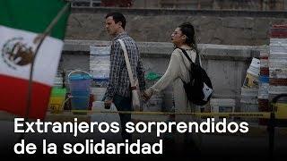 Extranjeros sorprendidos de la solidaridad - Foro Global