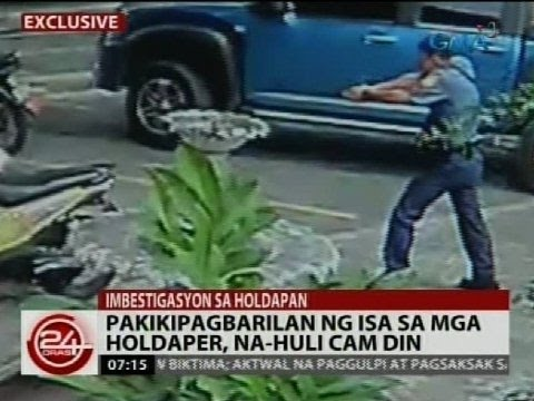 Exclusive Pakikipagbarilan ng isa sa mga holdaper na hulicam