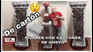 PILAR O PEDESTAL  DE CARTON CON CARTONES DE HUEVO