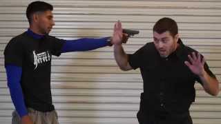 Self Defense Tactics: Gun To Head Disarm