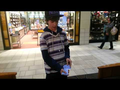 Some kid doing crazy card tricks at the mall
