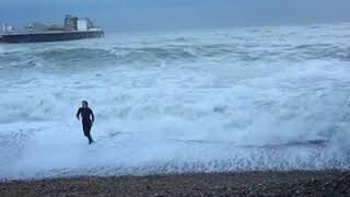 Woman rescues dog from stormy seas at Brighton