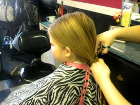 8 year old girl donates her hair to Wig's for Kids